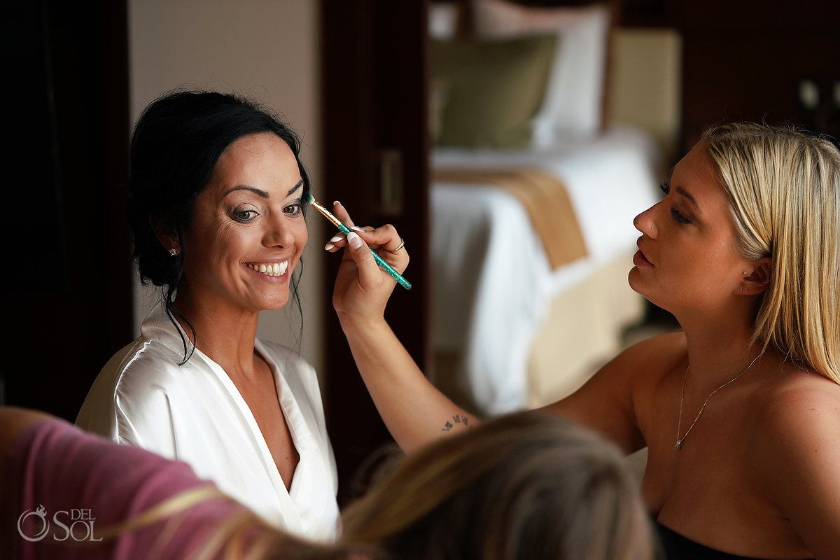 bride getting makeup done by husband's daughters secrets Playa Mujeres