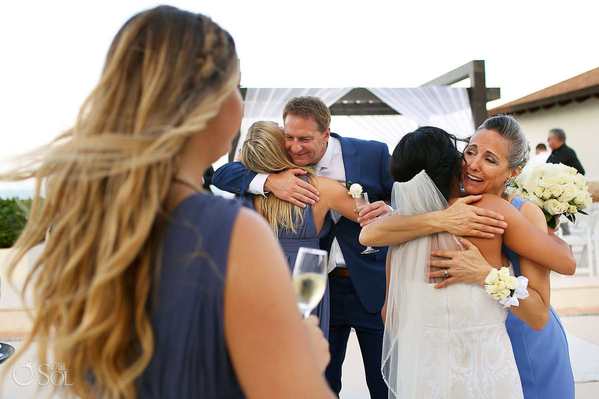 hugs after wedding ceremony Secrets Playa Mujeres