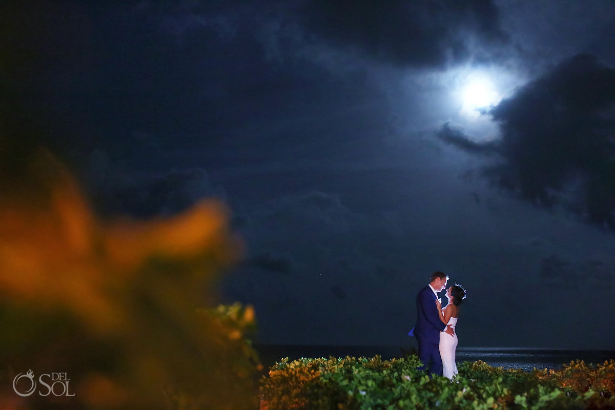 Bride and groom moonlight portrait