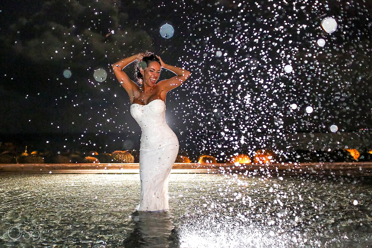 Fun bride portrait in the swimming pool Secrets Playa Mujeres