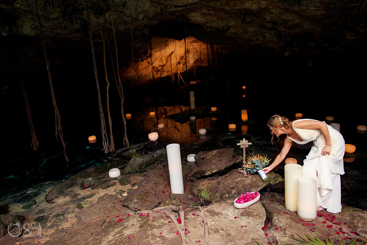 Bride places her bouquet in a cenote