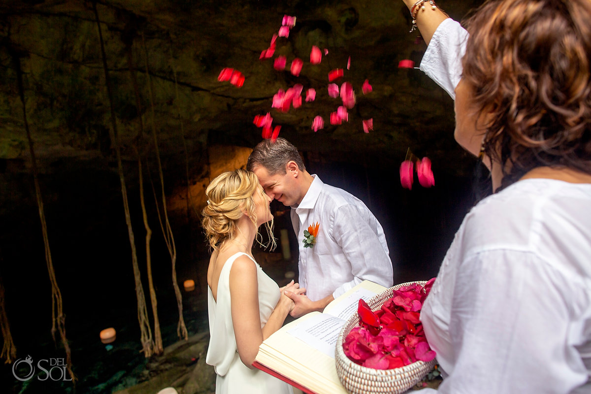 cenote ceremony first kiss with rose petal blessing