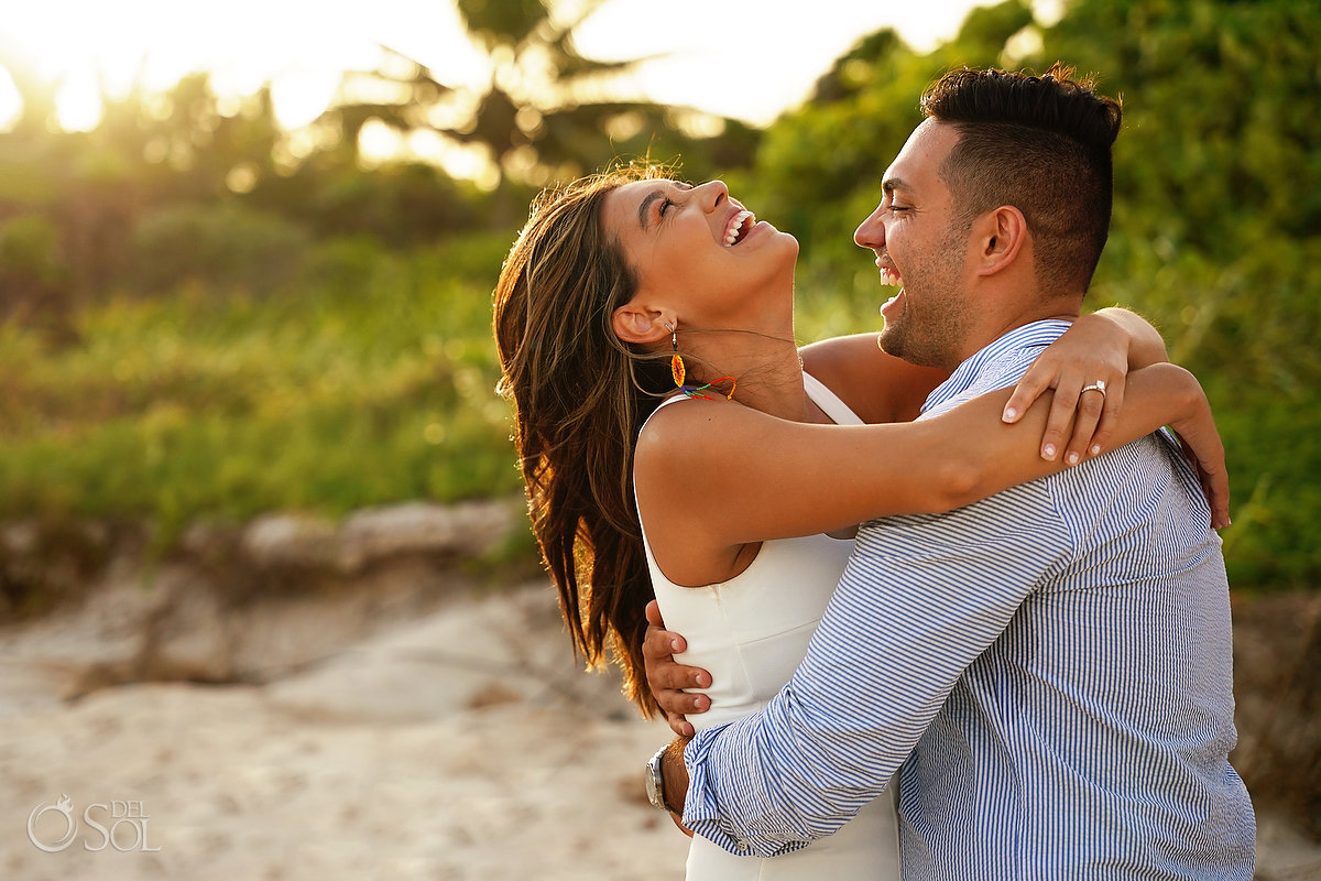 Happy couple just engaged sunset beach proposal Dreams Tulum Mexico