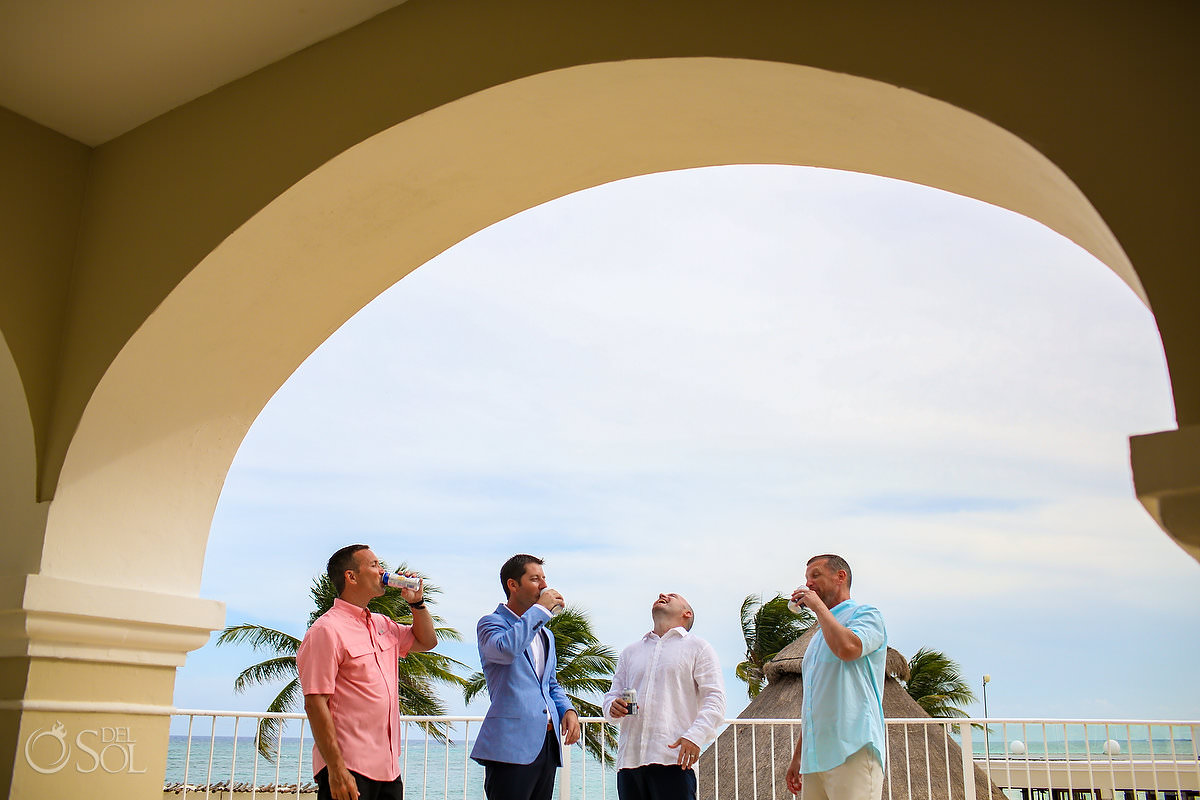 Groom and Groomsmen getting ready oceanfront suite Dreams Tulum Riviera Maya mexico