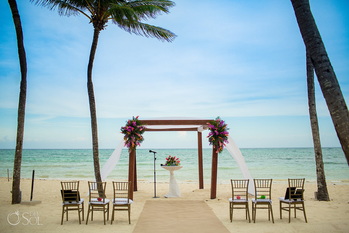 Dreams Tulum Central Beach wedding ceremony setup bright tropical flowers