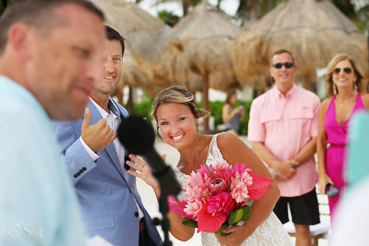 Dreams Tulum Zoom Wedding bride waves at computer screen