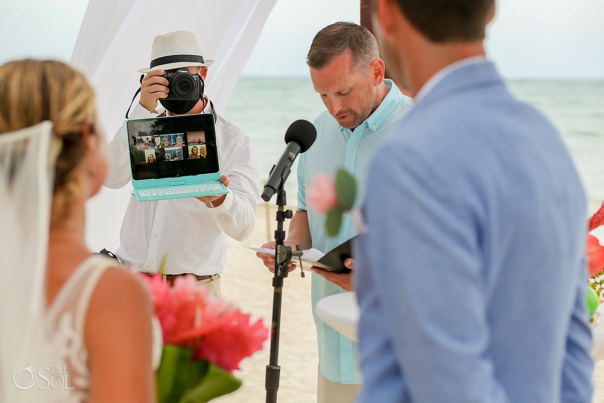 Dreams Tulum Zoom Wedding photographer holding computer with people watching from home