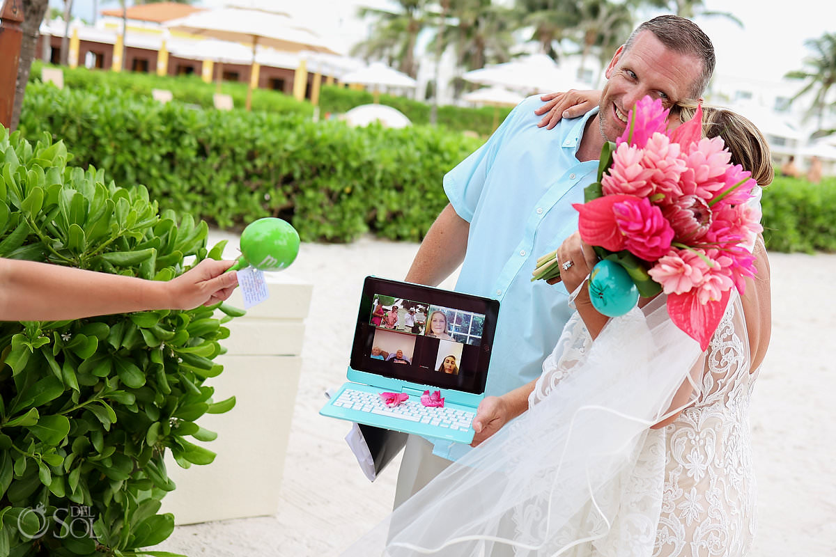 Dreams Tulum Zoom Wedding bride gugs guest holding computer with remote guests