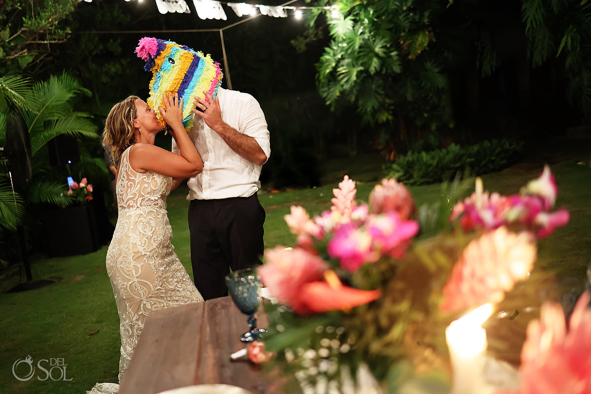 funny wedding photo groom with pinata on head