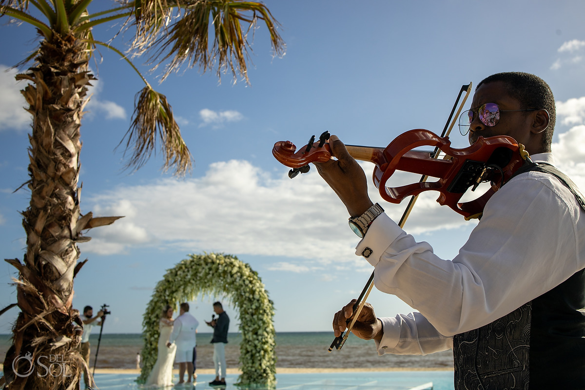 Violin player Dreams Natura Wedding Ceremony Infinity Pool Riviera Cancun Mexico