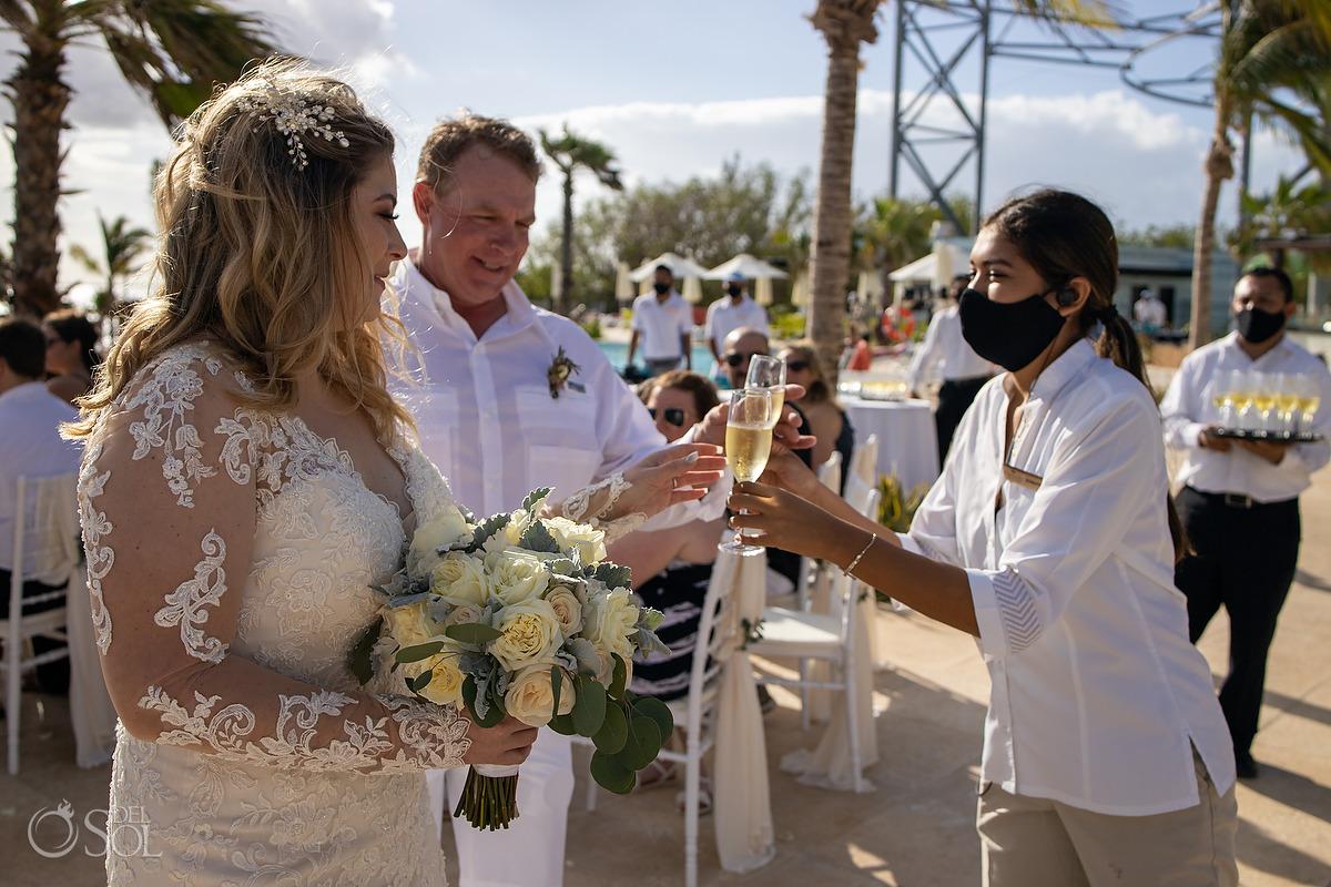 Dreams Natura Wedding coordinator champagne toast Riviera Cancun Mexico