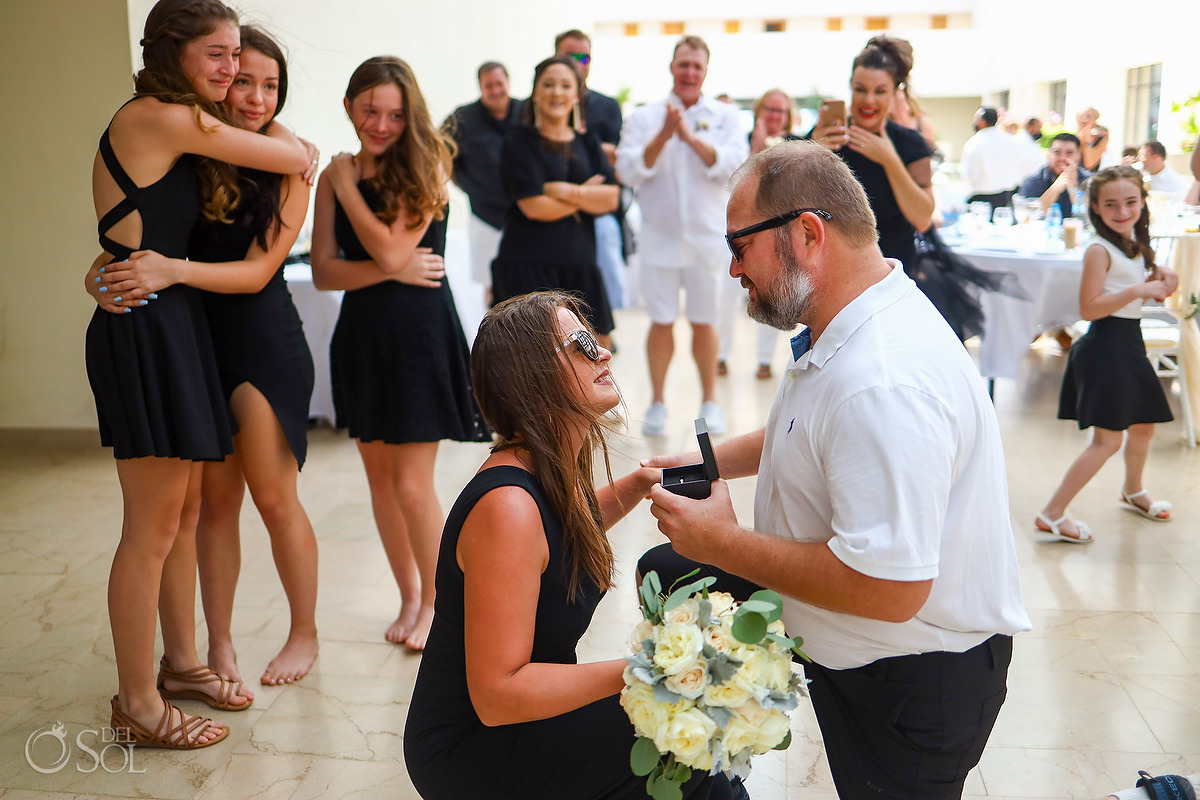 Surprise Proposal during wedding reception bouquet toss Dreams Natura Riviera Cancun Mexico