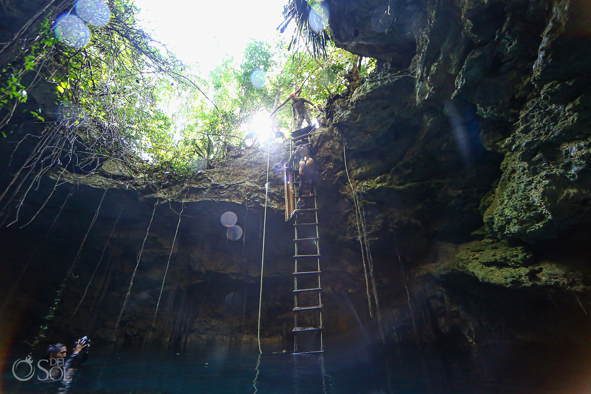 extreme underwater photoshoot behind the scenes climbing down ladder into a cave Riviera Maya Mexico