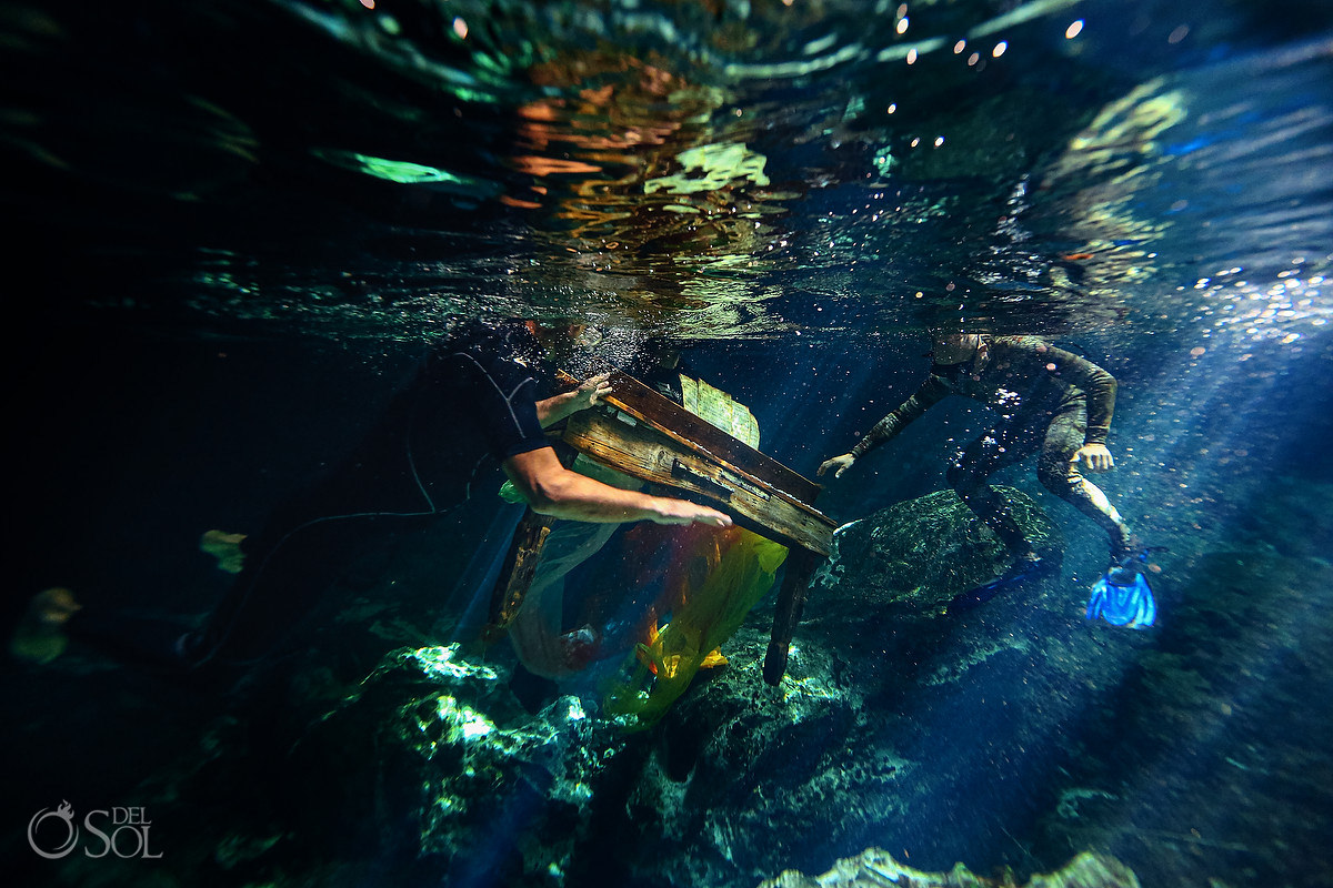 behind the scenes at an underwater trash the dress photoshoot mexico