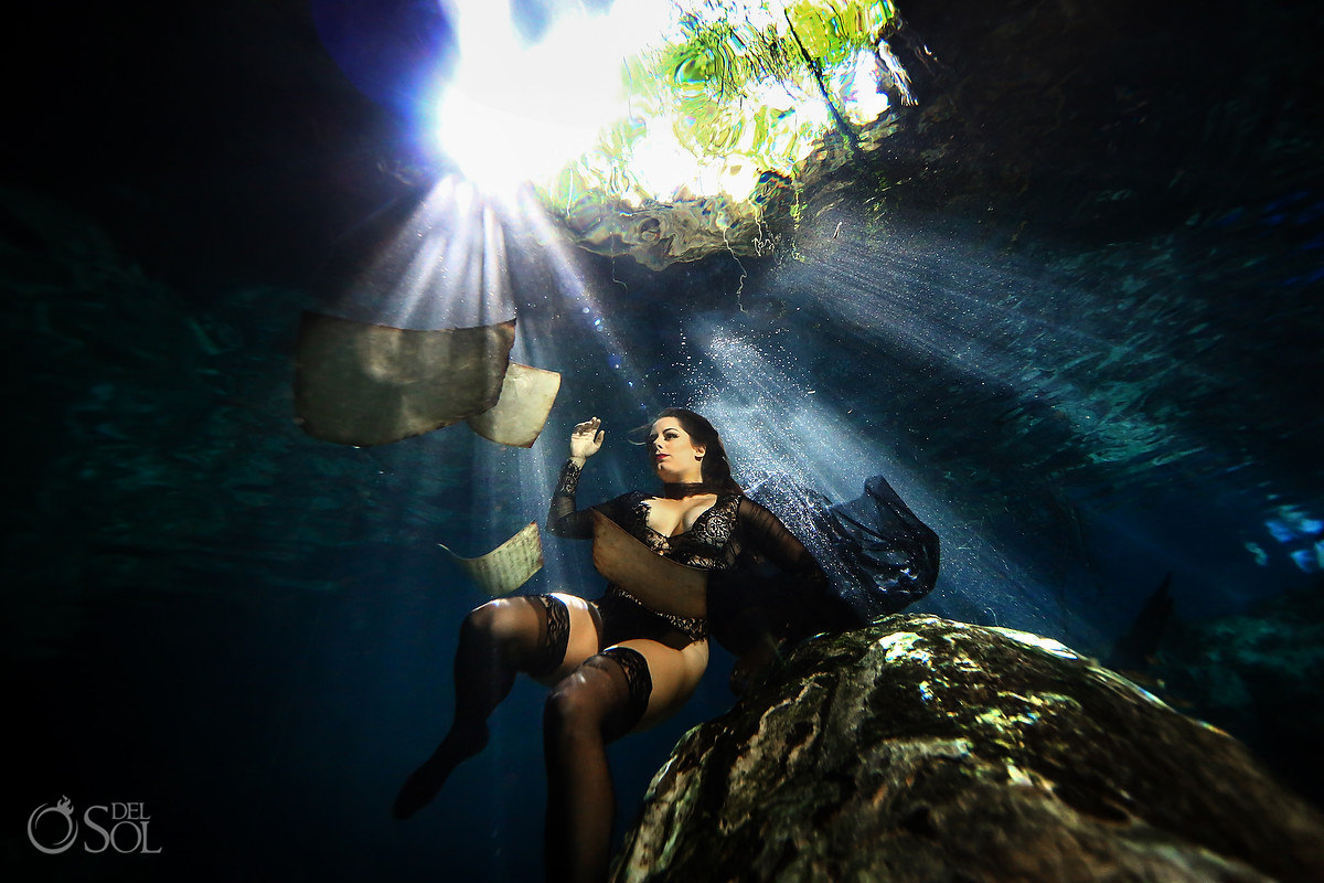 musician creates amazing underwater portraits sheets of music falling through water Mexico