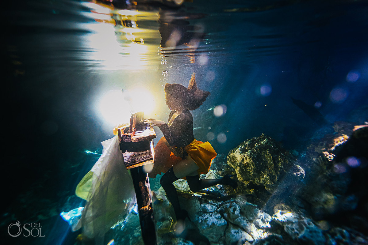 Underwater piano player creative fine art boudoir photoshoot Playa del carmen mexico