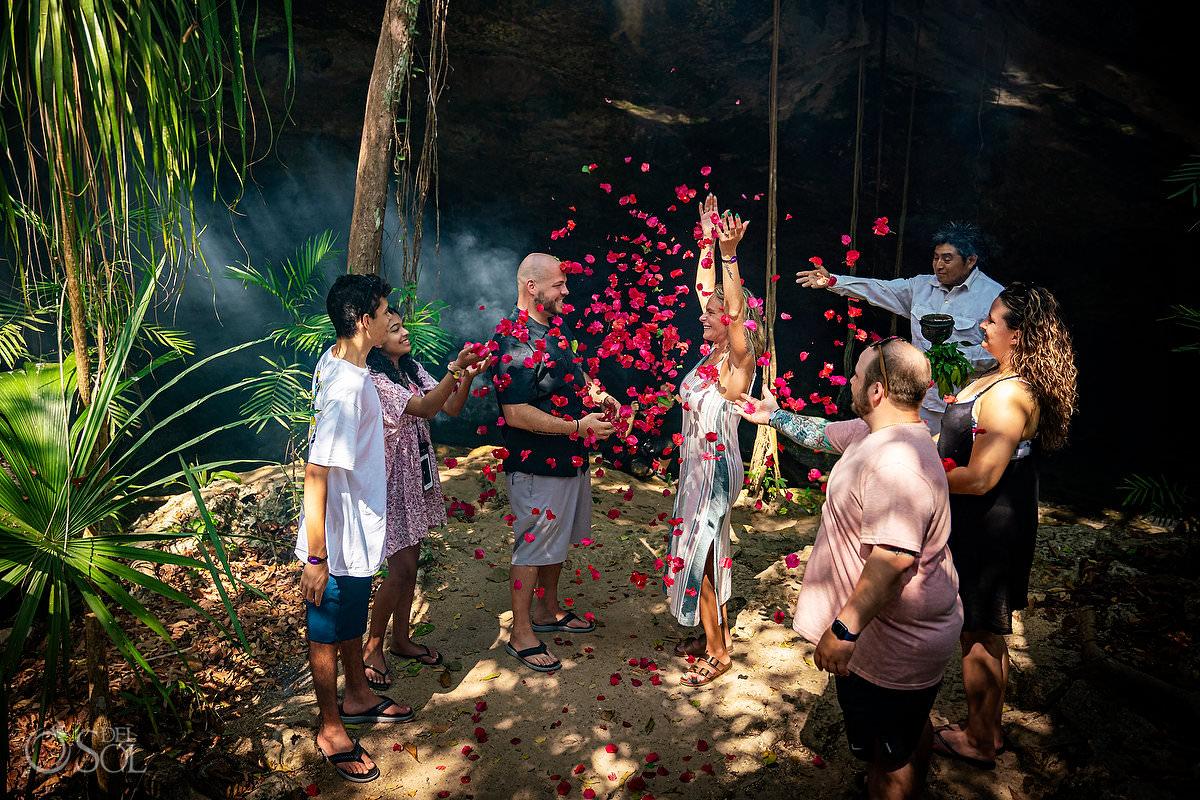 celebration throwing flowers mexico cenote proposal Tulum Riviera Maya