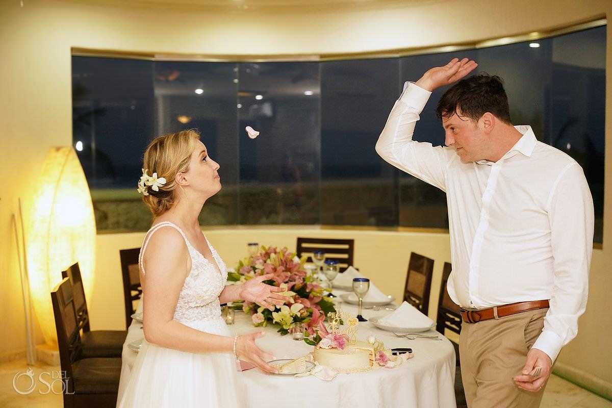 funny wedding photo groom throwing petal at bride