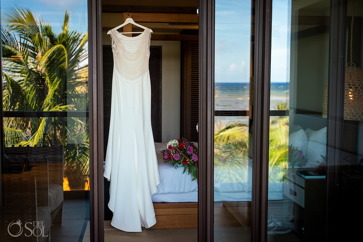 Rima lav wedding dress hanging in Unico Riviera maya suite balcony