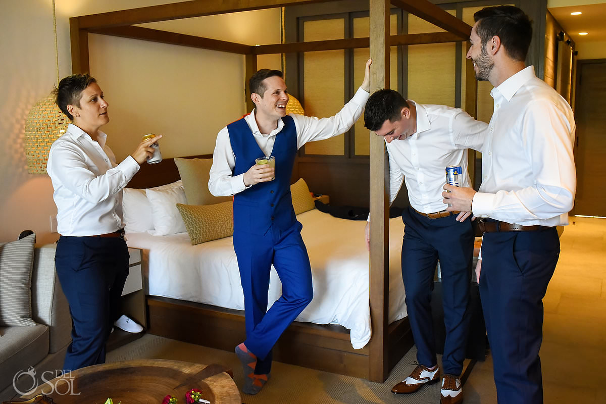 groom and groomsmen getting ready in unico suite