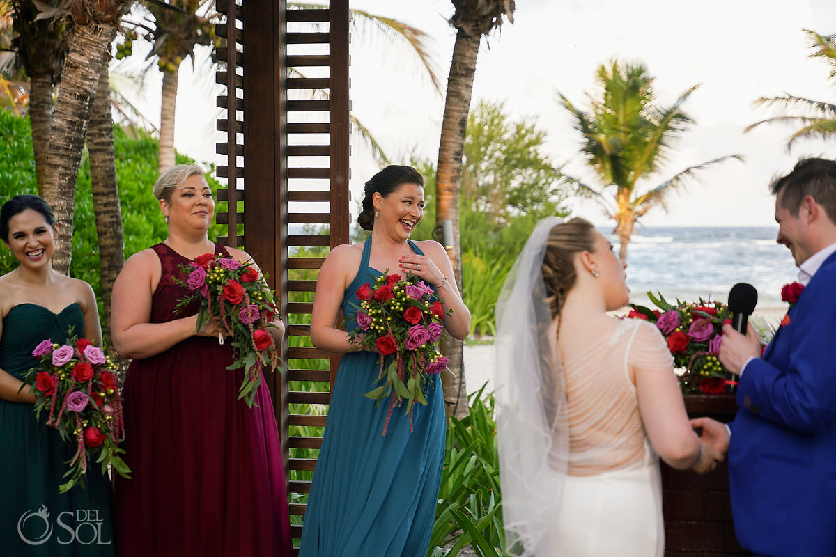 bridesmaids in mismatched wedding dresses teal, claret and green